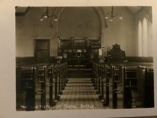 Interior of Settle Primitive Methodist Chapel. Notice the Edwardian pulpit to the side. | Postcard from collection of Revd Steven Wild