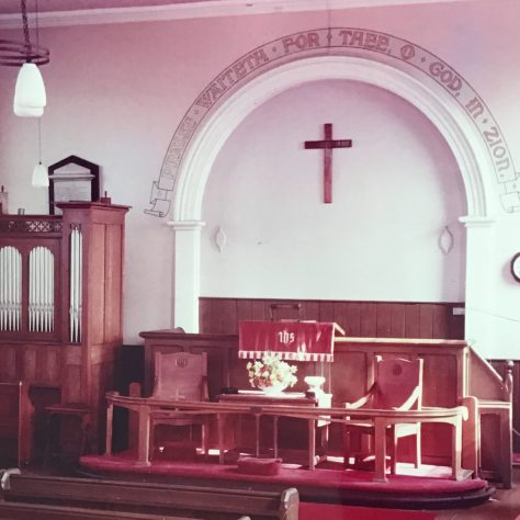interior of 1864 Saughall  Primitive Methodist chapel, complete with text on the wall  | provided by Alison Dean