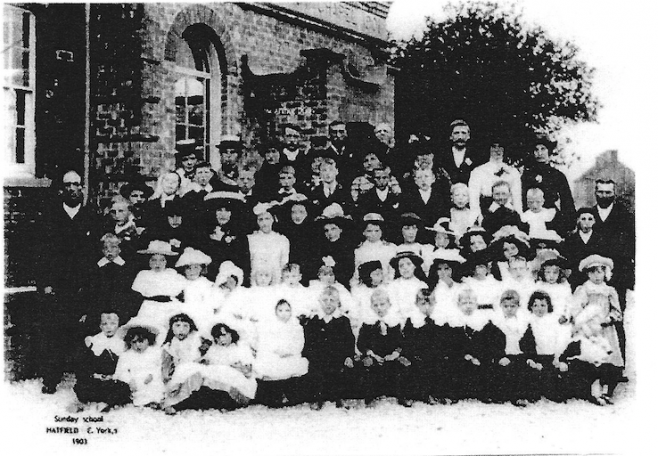 Sunday School scholars and staff outside the chapel, possibly on the ocassion of the annual treat