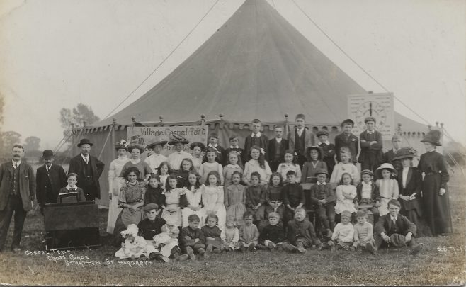 Mr Macphie's Gospel Mission   Tent c.1912 Stratton Park Cross Roads (Stratton St Margaret). Howard Hill at the harmonium | Hill family collection