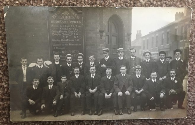 A young men's group outside an unnamed Primitive Methodist church; later identified as Washbrook Primitive Methodist Church, it became simply Washbrook Methodist Church and latterly South Chadderton Methodist Church.     from a postcard provided by Mark Graham 2021