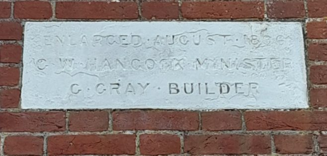 eroded stone plaque at the former Dilham Primitive Methodist chapel | provided by Shena Cumiing 2021