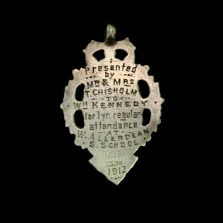 Reverse of Watch Fob showing presentation details.