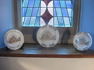 Three chapel plates on display in the chapel