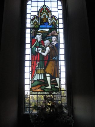 One of the stained glass windows at the back of the chapel