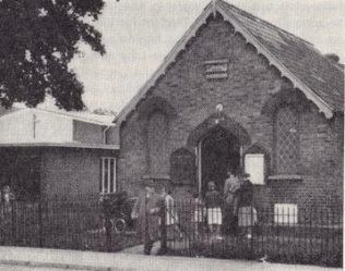 The 1868 chapel with, to the left, the dual-purpose hall built in 1957