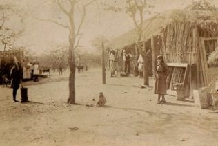 This is of Sajobas village.  My grandmother is holding my mother as a baby. I think the teenager at the right of the picture could be one Walter's other daughters from his first marriage, and the woman standing behind my grandmother another daughter,