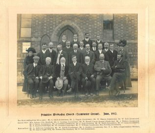 Primitive Methodist Church (Leominster Circuit). June, 1912. Top Row (reading from left to right) : Mr. G. Smith (Leominster), Mr. J. Higgins (Leominster), Mr. W. Hancox (Leominster), Mr. W. Beck (Leominster). Second Row: Miss Roberts (The Hundred), Mr. J. Goodman (Leominster), Mr. W. Russell, Circuit Steward (Pembridge), Mr. J. Watkins (Leominster), Mr. J. Bayley (Leominster), Mr. J Goodman (Shirlheath), Mr. C. Ford (Stockton). Mr. W. Smith (Leominster), Mr. P. Owens (Leominster), Mr. T. Russel (Pembridge), Mr. W. Goodwin (Pembridge), Mr. T. Williams (Leominster), Miss. Dowding (Leominster). Bottom Row: Mr. A Anderson (Leominster), Mr. W. Powell (Leominster), Mr. S. Kimbery (Leominster), Rev. T. A. Kelly (Superintendant Minister), Mr. W. Harris (Upper Hill), Mr. Probert (The Hundred), Mr. E. Cole (Leominster).