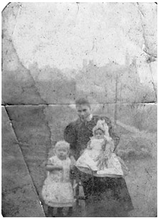 A faded photo found in the family bible shows Mary Ann with two children (presumably William and Beatrice) probably taken in the early 1890's.