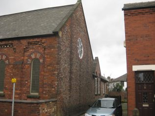 View of rear of Chapel with a stain-glass round window