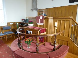 Communion table, plush runner and pulpit cover given by Samuel and Elizabeth Forrester in 1928 | Dianne Gibson