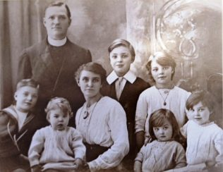The Goodreid Family c1920.  Dorothy(our mother) is in back row right; Phoebe, 100 later this year (2016), is bottom row second from left | Family photograph