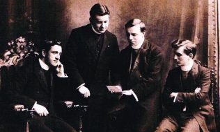 T R Spray is second from left. Who are te others? Was this taken at Hartley College?