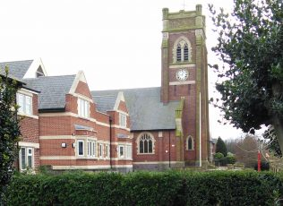 Church with new building replacing school to the side   Christopher Hill 2015