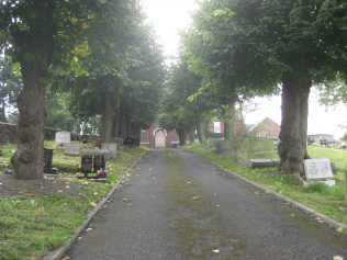 Driveway up through graveyard to chapel building