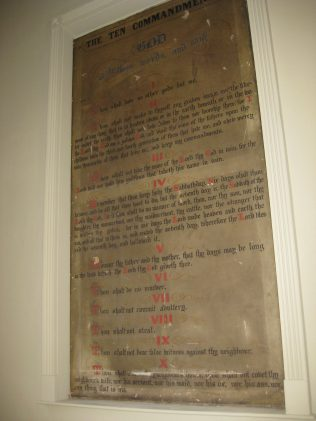 A plaque of the Ten Commandments still on the wall inside the wine bar
